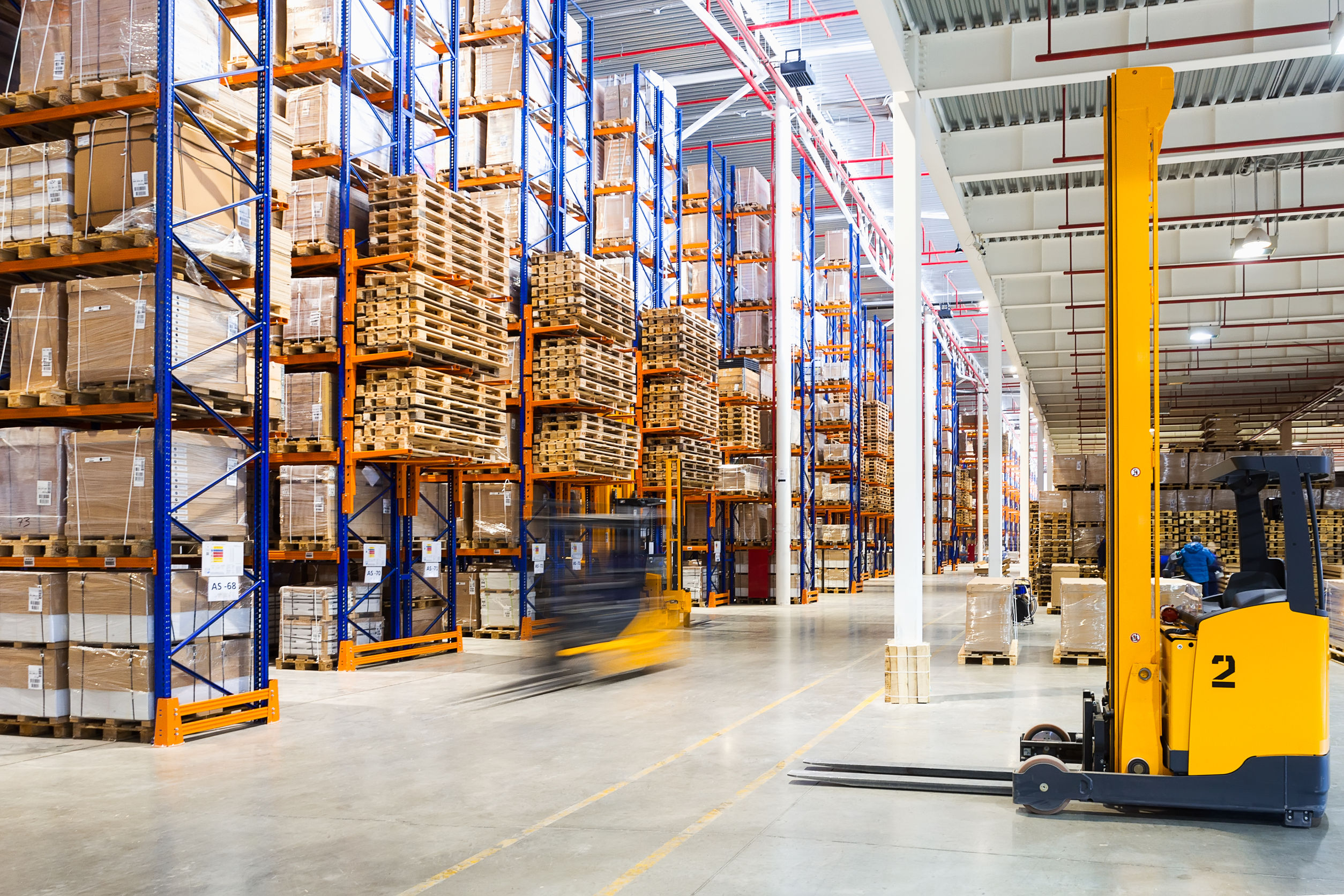 55748049 - large modern warehouse with forklifts